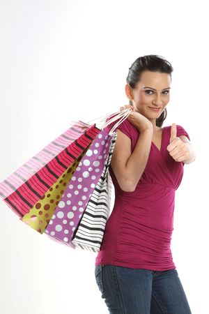 Modern teenage asian girl with shopping bags photo