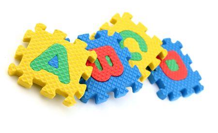 Alphabet Puzzle Pieces on White Background  Stock Photo - 7108417