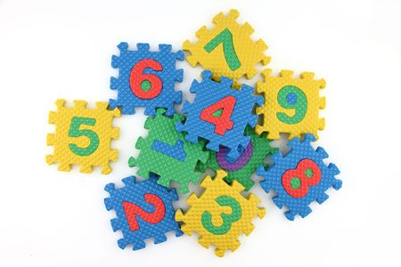 Numbers puzzle scattered on white background photo