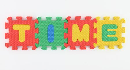 TIME word arranged in alphabet puzzle Stock Photo - 7108419