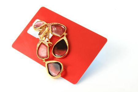 Gem stone earrings on red sim card Stock Photo - 7108420