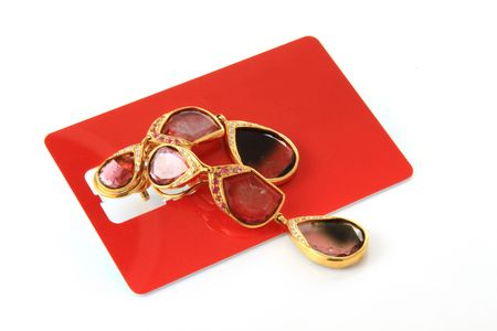Gem stone earrings on red sim card Stock Photo - 7108423