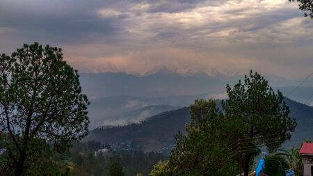 Himalayan Mountain view from peak during sunrise in India