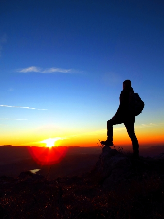 On the top with backpack photo