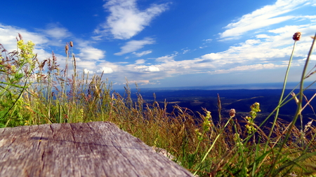 View from a bench on mountain summit Stock Photo