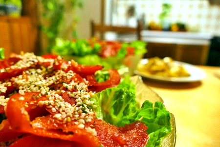 Salad with red paprika and green lettuce on table Stock Photo