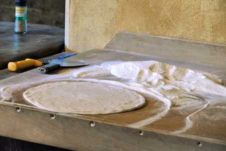 Dough and flour ready for making pizza