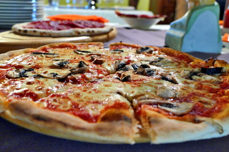 Pizza with mushrooms and olives on table, close up view Stock Photo