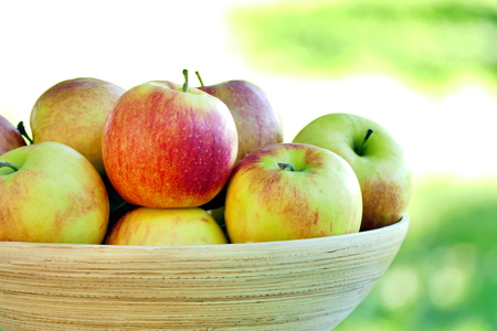 Organic apples in basket. Close up view. Stock Photo
