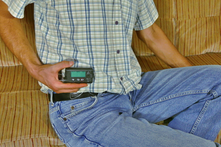 Diabetic with insulin pump in hand