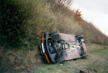 upside down: Car accident - car lying upside down in the slope Stock Photo