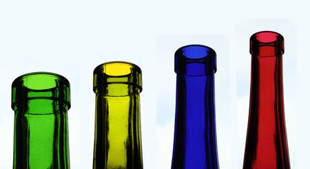 four glass bottles in different colours, red, yellow, blue, green Stock Photo - 7610257
