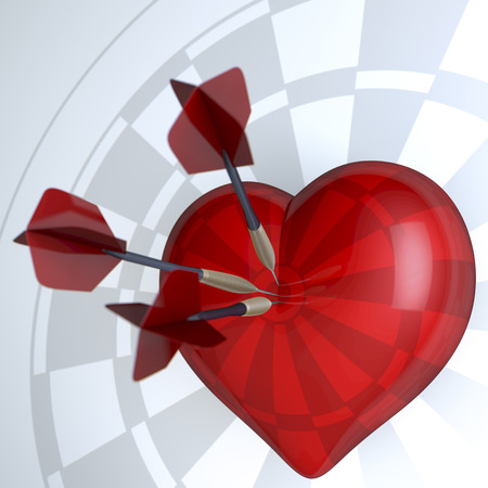 romance strategies: Red heart as dart target, three darts sticking in heart Stock Photo