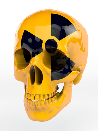 Yellow lacquered black skull with radioactive sign photo