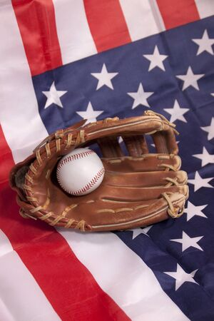 sporting equipment: Baseball and glove on American flag Stock Photo