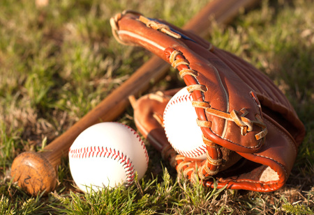 bat and ball: baseball bat, ball and glove on grass