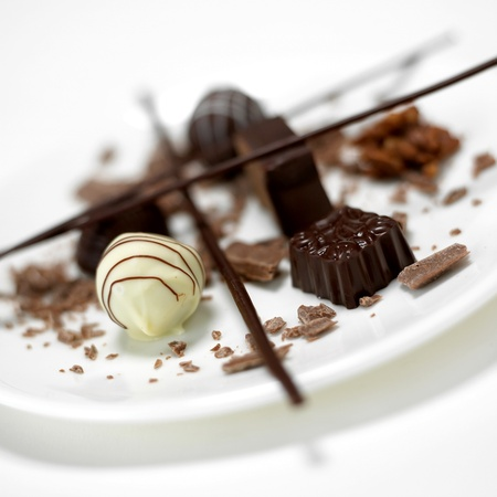 chocolate pralines, white,black chocolate on plate