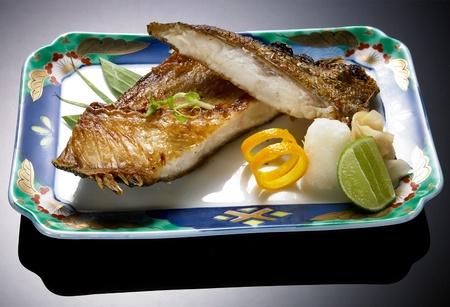Grill fish with sauce , Saba fish teriyaki sauce japanese food with lemon