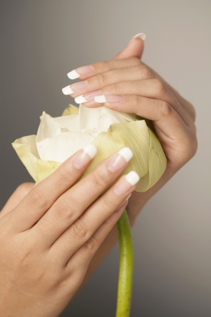 white lotus flower, Nice hands with nail art photo
