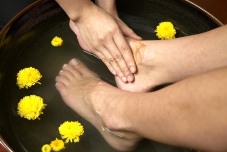 reflexology foot massage, spa foot treatment by hand herb,Thailand Stock Photo - 20874356