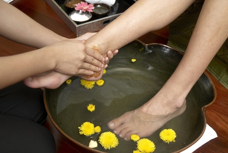 traditional healer: reflexology foot massage, spa foot treatment by hand herb,Thailand