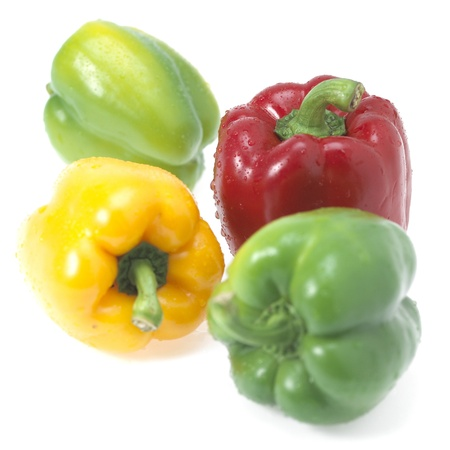 four fresh sweet pepper isolated on white background Stock Photo