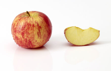 ripe red apples and half of apple. Isolated on a white background.