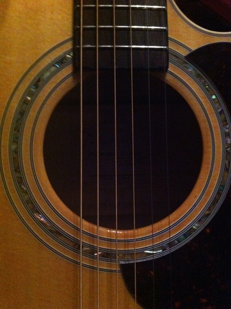 soul: Focus on a light brown 6-strings acoustic guitar