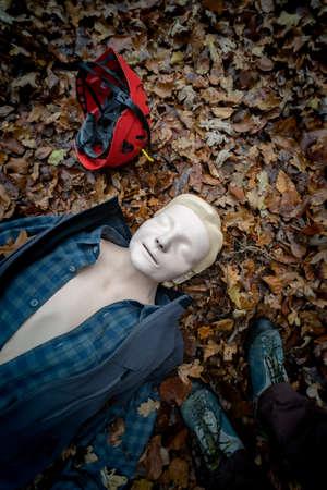 Single resuscitation dummy in the forest Foto de archivo