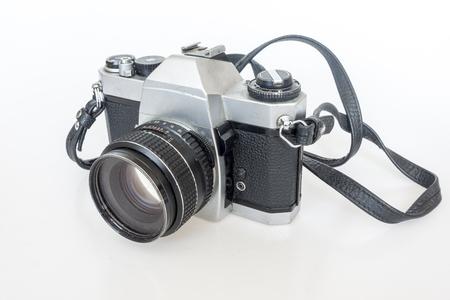 old SLR camera film isolated on white