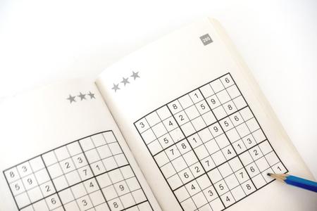 brain teaser: sudoku book isolated on white