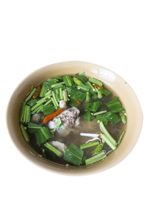 thai food, spicy soup with herb isolated on white