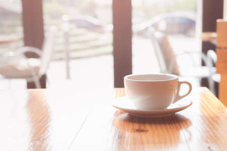 good morning a tea or coffee cup on wooden table in coffee shop
