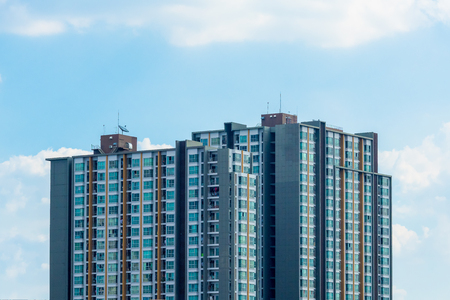 Condominium or apartment building on blue sky in the city downtown. Stock Photo