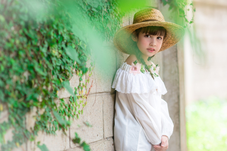 a little cute girl alone in the garden or farm and outside in nature