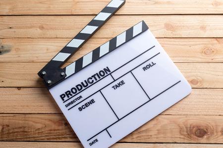 movie clapper board on wood Фото со стока