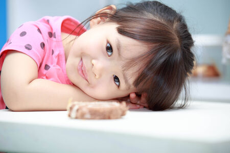 ideally: Asian girl sitting smiling happily acted ideally.