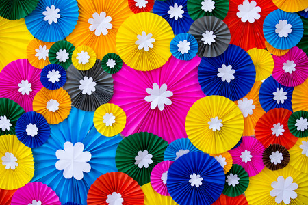 Colorful paper flowers wall background. Фото со стока