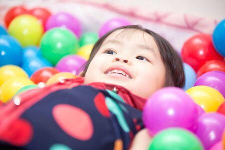 Asian cute girl playing balls.