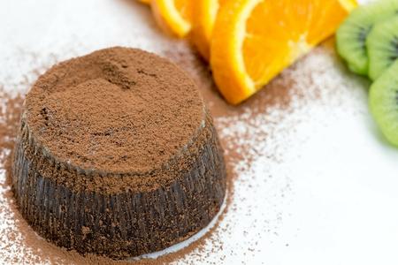 Hot chocolate pudding with fruit Фото со стока