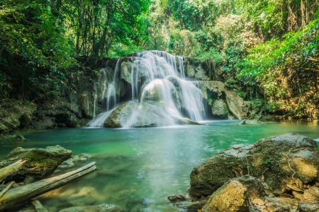 Waterfall in forest, emerald green water  photo