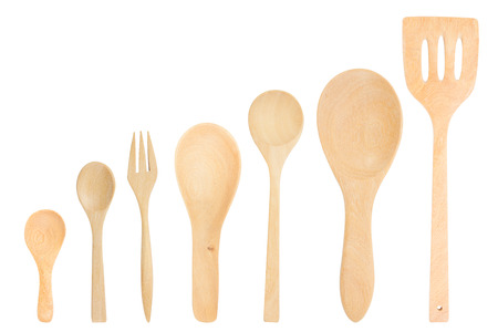assorted wooden cutlery on white background photo