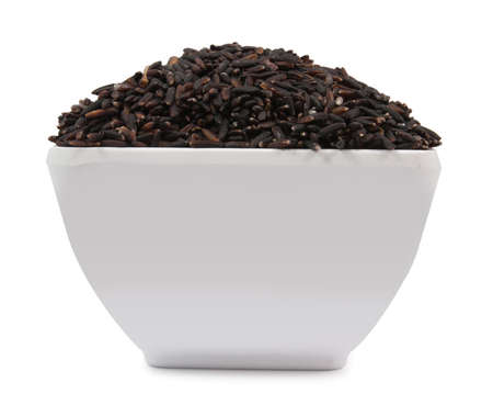 Black rice on cup isolated on a white background photo