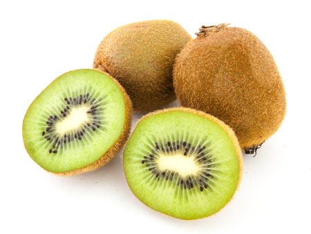 perfectly: A perfectly fresh kiwi fruit isolated on white.