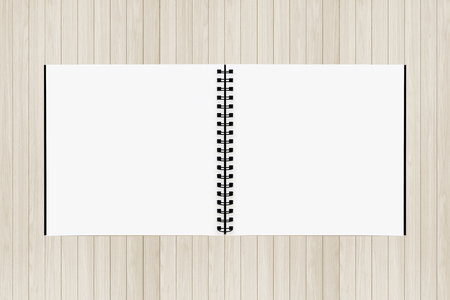 Drawing book on Wood background photo