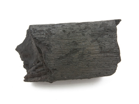 activated: many pieces of charcoal isolated on white background