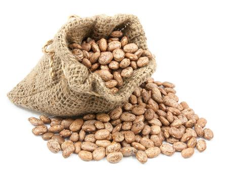 roman beans: pinto beans in canvas sack on white background