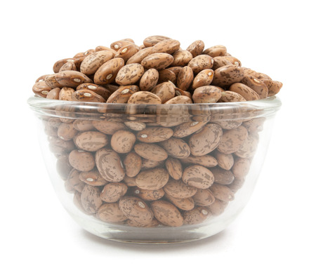 roman beans: pinto beans on glass cup isolated on a white background Stock Photo