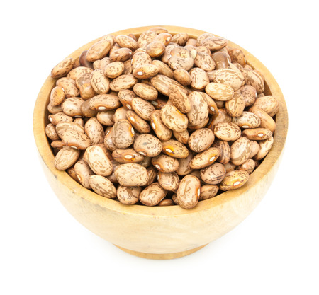 roman beans: pinto beans on wood cup isolated on a white background