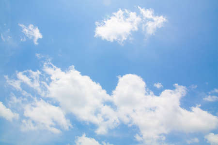 high up: White clouds in a blue sky. Stock Photo